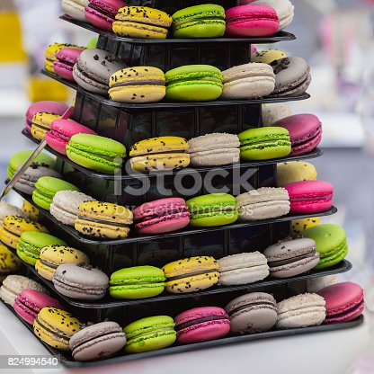 istock Pyramid of different french colorful macaroons various flavors and diffrent colors, french sweet cookies from almond flour, on market counter 824994540