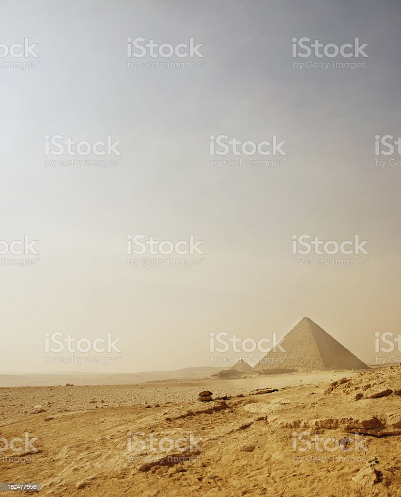 Pyramid of Giza on an arid landscape royalty-free stock photo
