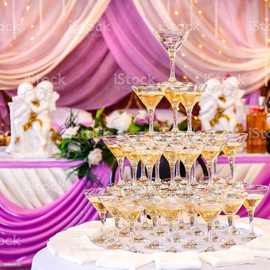 Pyramid Of Glasses With Champagne In Purple Wedding Interior Stock ...