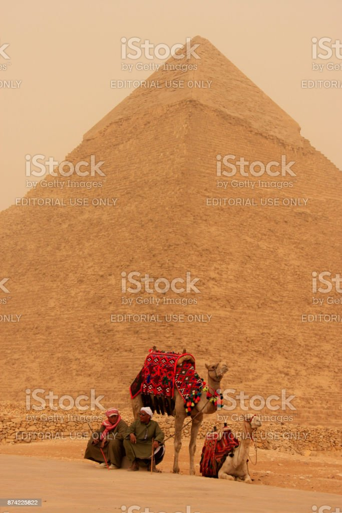 Pyramid of Khafre and camels at sand storm, Cairo, Egypt stock photo