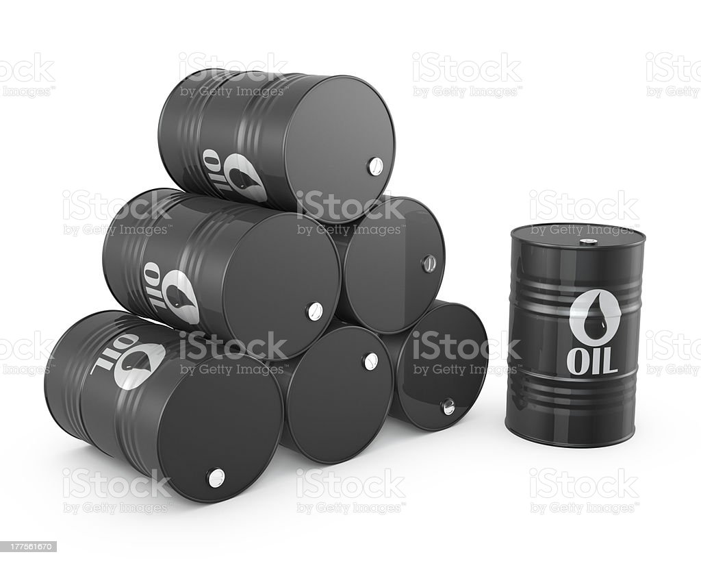 Pyramid of oil barrels and single barrel stock photo