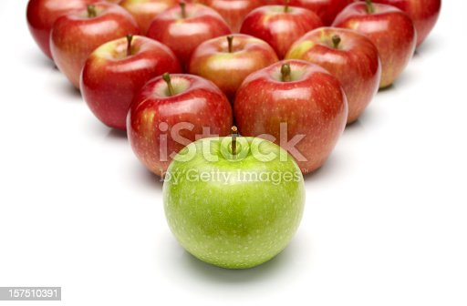 istock Pyramid of red apples with one green apple in the front 157510391
