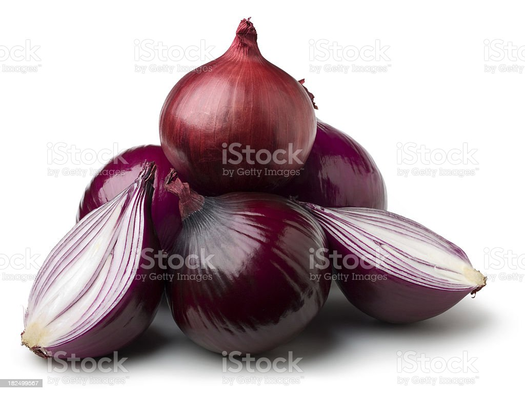 Pyramid of red onions with one cut in half royalty-free stock photo