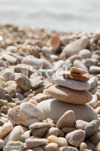 istock pyramid of stones on a background of stones 1151155422