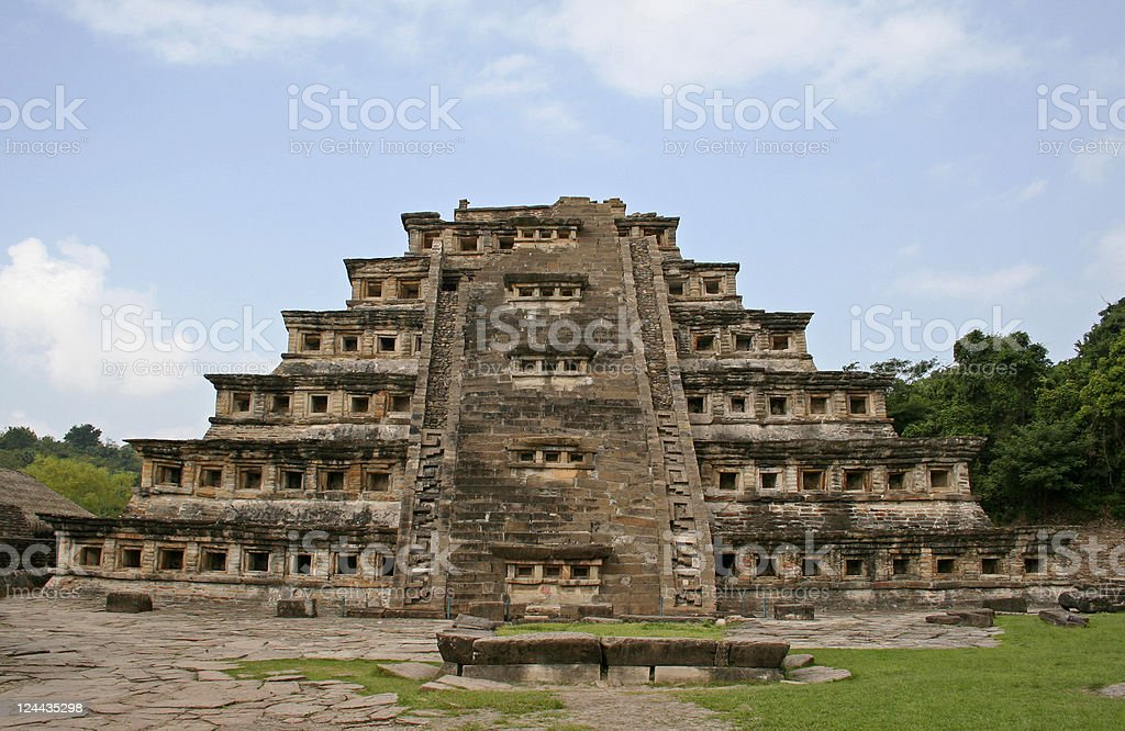 Piramide de los Nichos in El Tajin Front view of Piramide de los Nichos in El Tajin, the most interesting and highest structure in this famous archaeological site in Veracruz, Mexico. Ancient Stock Photo