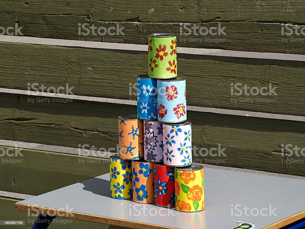 Pyramid of tin cans for throwing balls at them stock photo