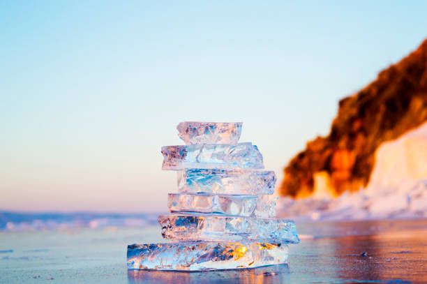 Pyramid of transparent pieces of ice on the surface of the lake Baikal stock photo