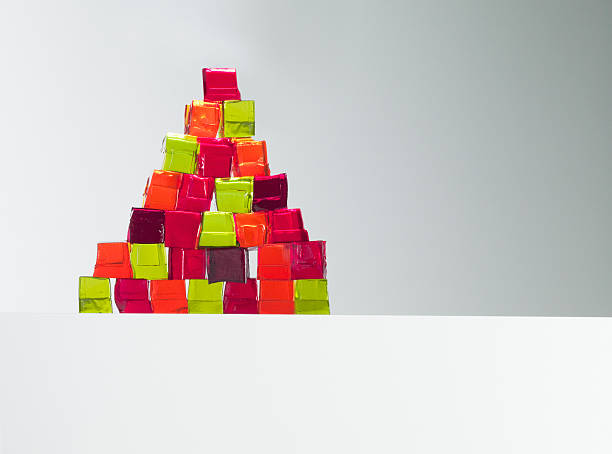 Pyramid of vibrant gelatin dessert cubes  jello stock pictures, royalty-free photos & images
