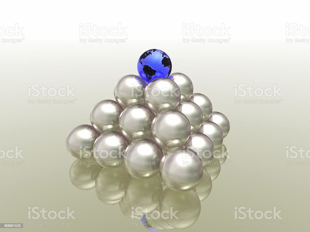 A pyramid of whites spheres topped with blue and black globe royalty-free stock photo