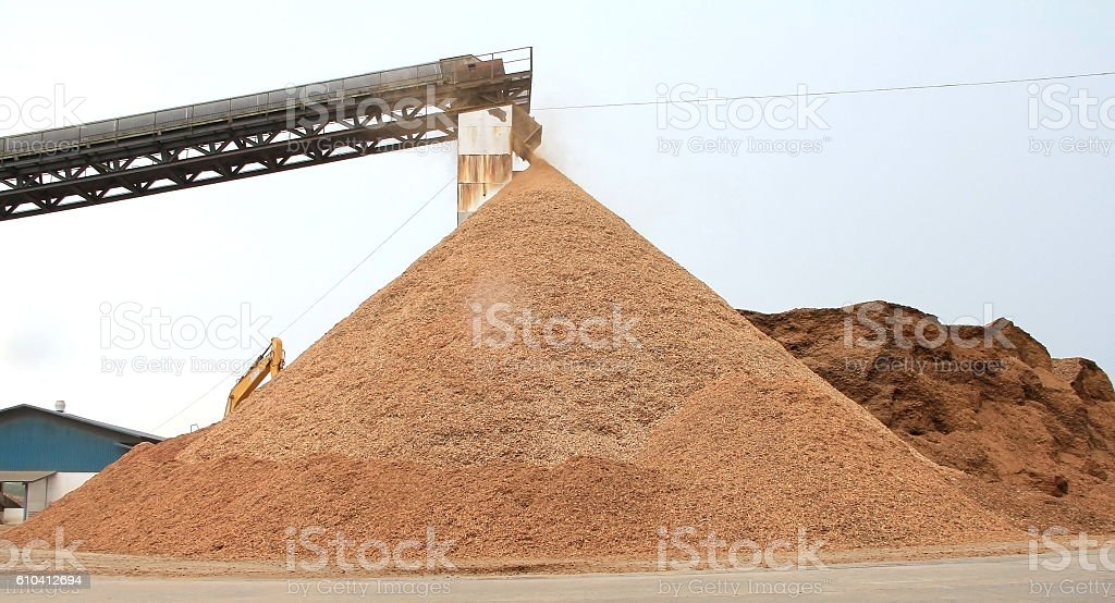 pyramid of wood chip in storage yard stock photo