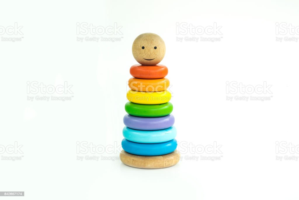 Pyramid toy composed of colorful wooden rings in a white isolated background stock photo