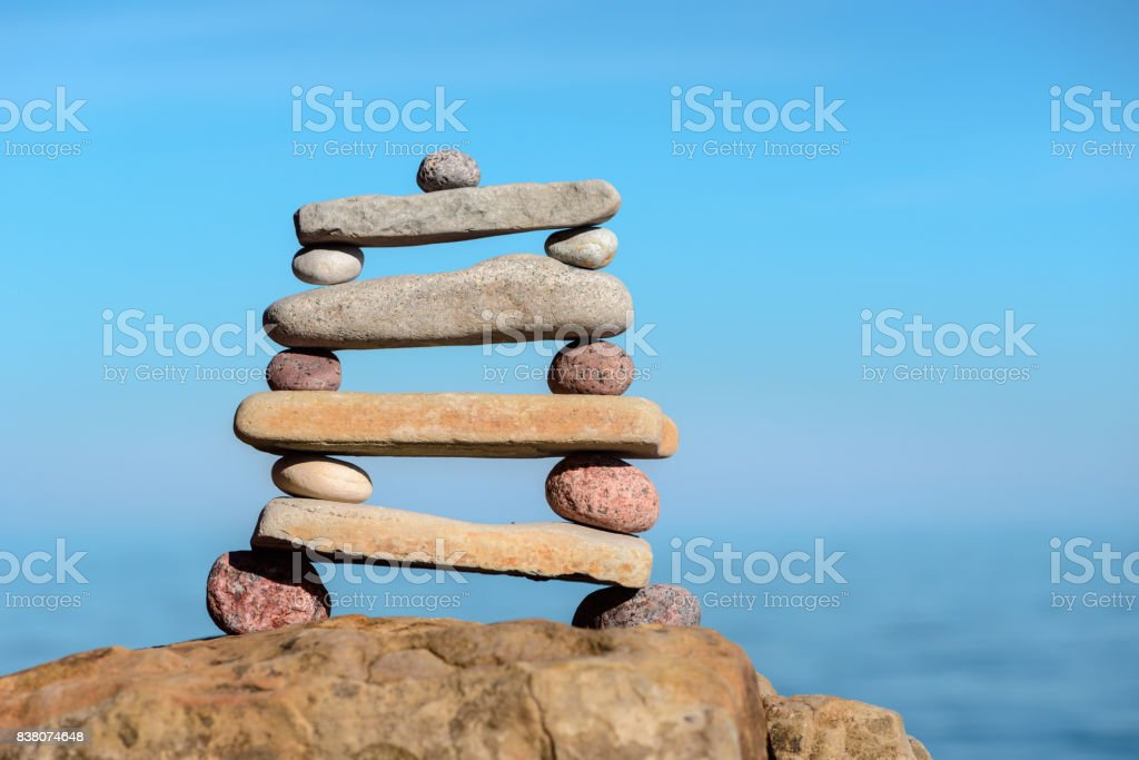 Pyramidal pile of pebbles stock photo
