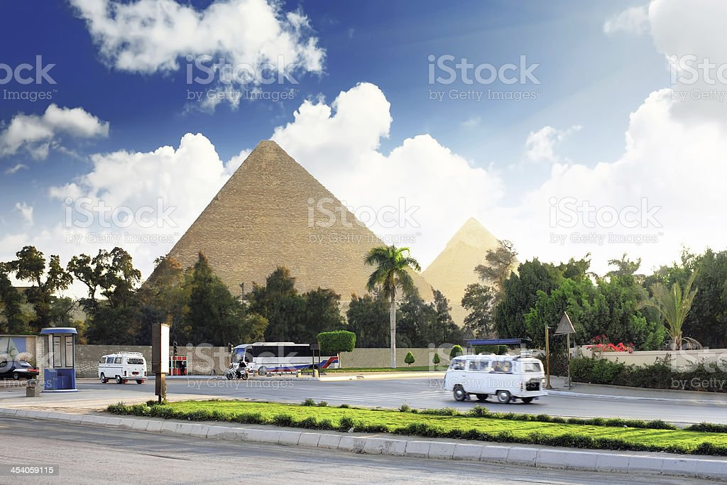 Pyramids and present day of Giza town royalty-free stock photo