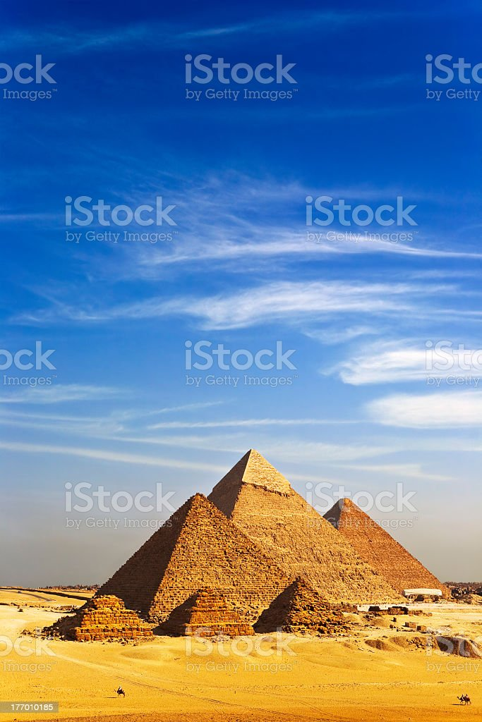 Pyramids at Giza under a blue sky with light cloud stock photo