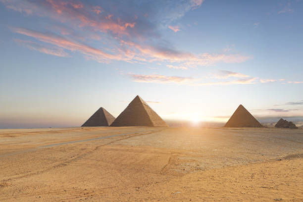 pyramids  in cairo, egypt - pyramid stock photos and pictures
