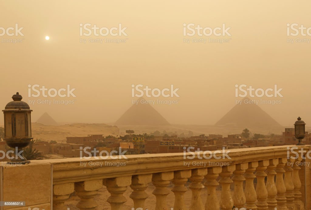 pyramids in Giza at sandy storm stock photo