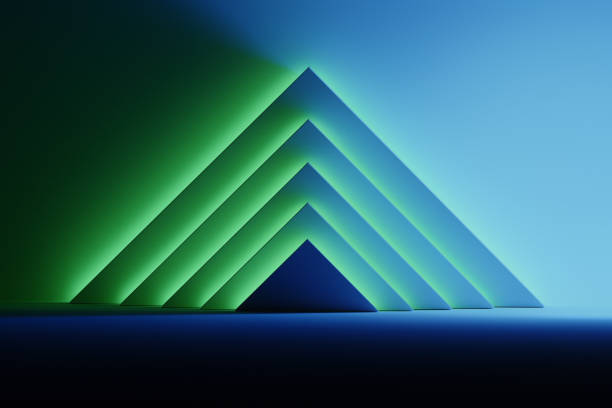 Pyramids in glowing blue and green light stock photo
