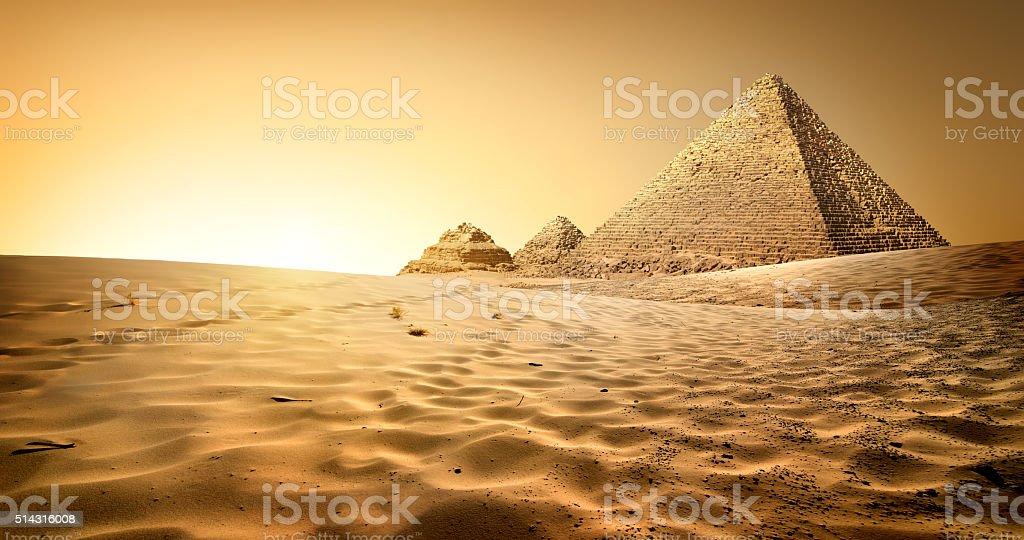 Pyramids in sand stock photo