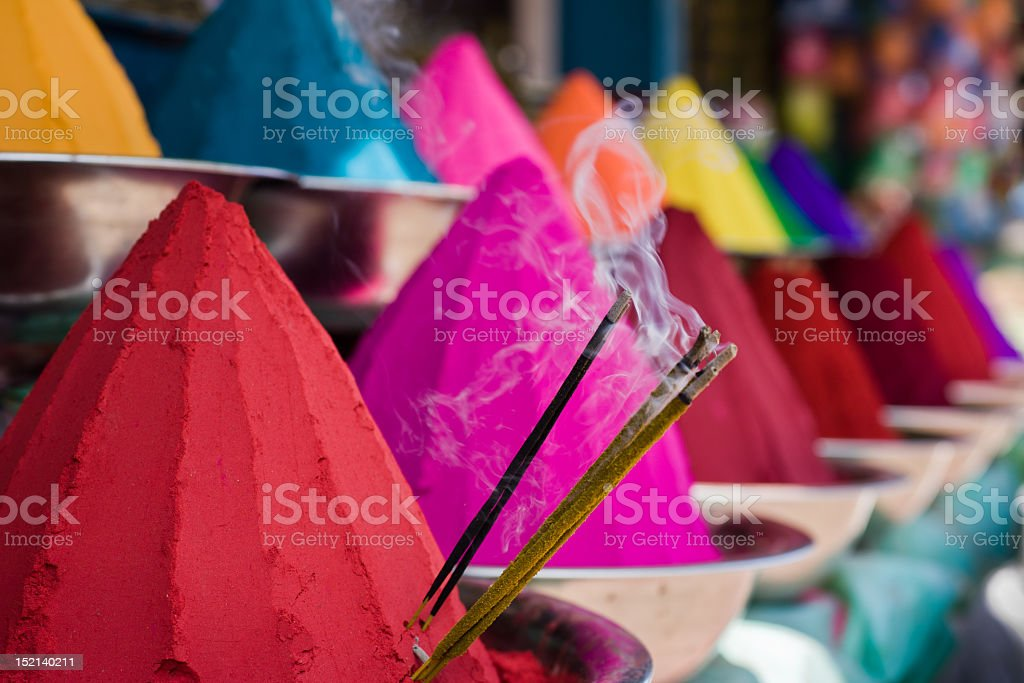 Pyramids of colored powder in bowls royalty-free stock photo
