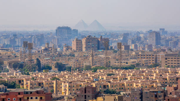 Pyramids silhouettes over Cairo, Egypt stock photo