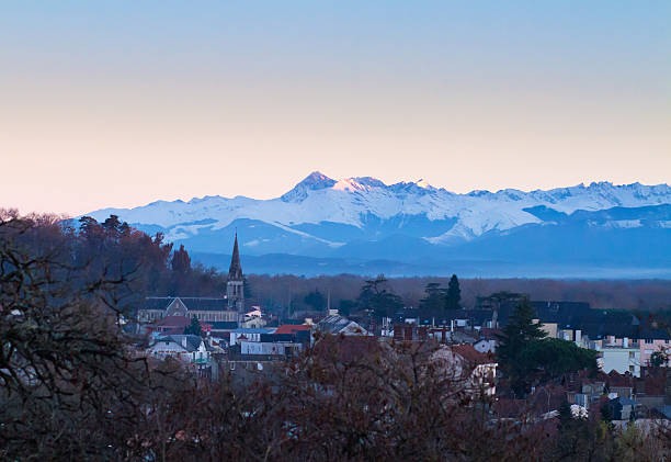 pyrennes at sunset with pau in foreground - bearn stok fotoğraflar ve resimler