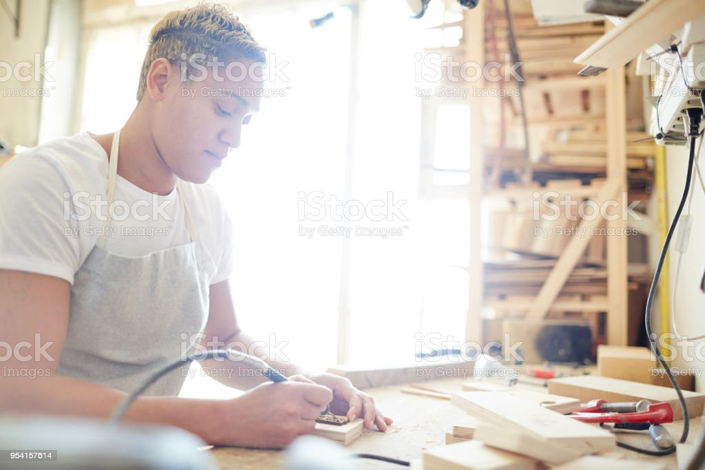 Pyrographic work stock photo