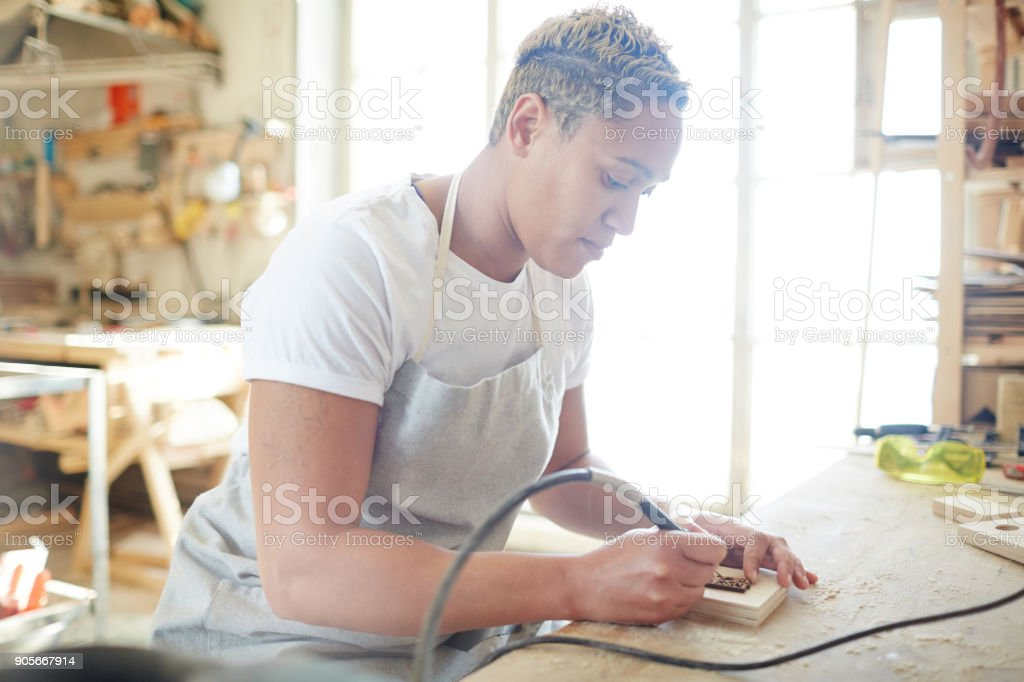 Pyrography specialist stock photo