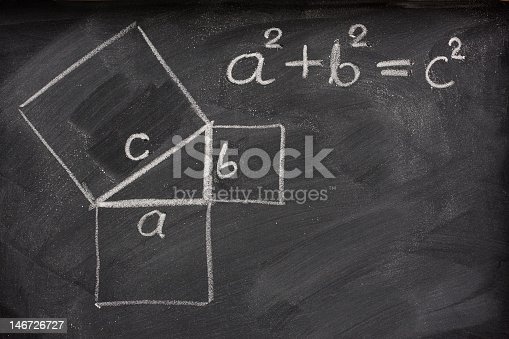Pythagorean theorem sketched with white chalk on a blackboard