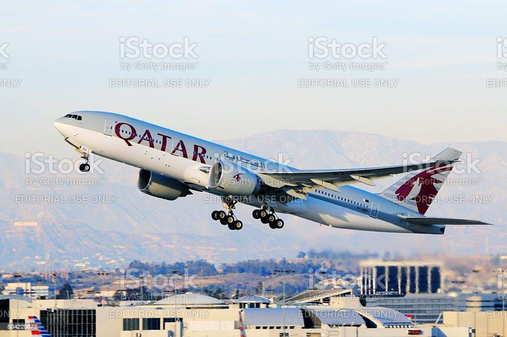 Qatar Airways Boeing 777-200LR taking off at LAX Airport stock photo