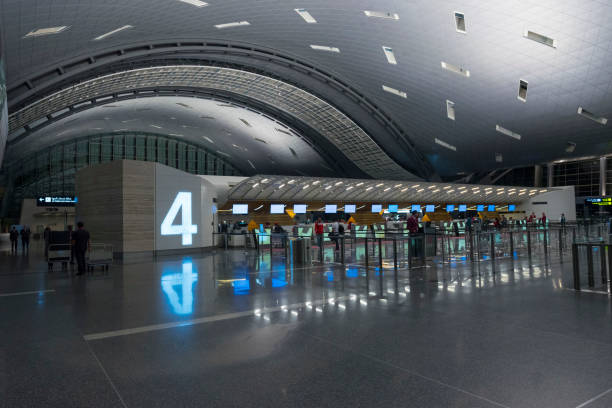 Qatar Airways check-in counter in the new and modern Hamad International Airport or Doha Hamad Airport in Doha stock photo