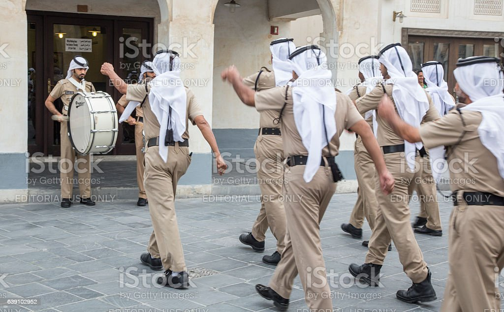 qatar policemen doing their daily march routine outside police station stock photo