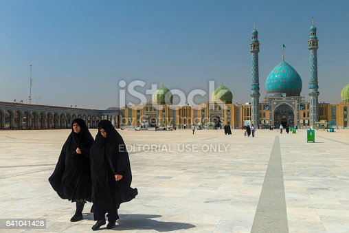 Qom- Iran. -may 14,2013: Muslim women with long robe in the courtyard of the Jamkaran Mosque. Jamkaran Mosque is a few kilometers outside the city of Qom and is in the south.