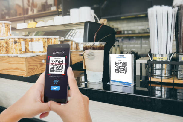Qr code payment, E wallet , cashless technology concept. Man scanning  tag in Coffee shop accepted generate digital pay without money. stock photo