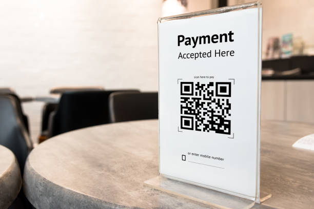 Qr code payment , online shopping , cashless technology concept. Coffee shop accepted digital pay without money , plastic tag on table. stock photo