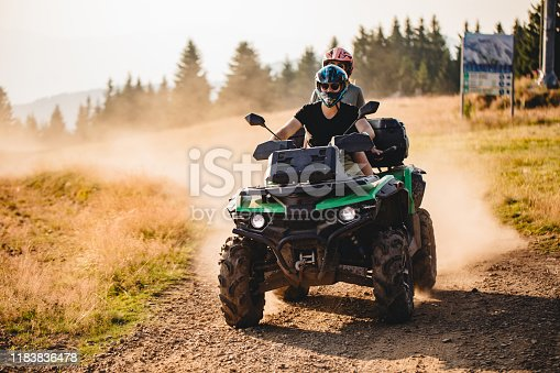 Extreme sports couple riding on a quad bike together