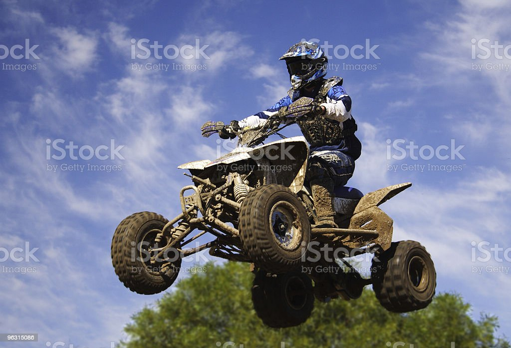 quad bike jump stock photo