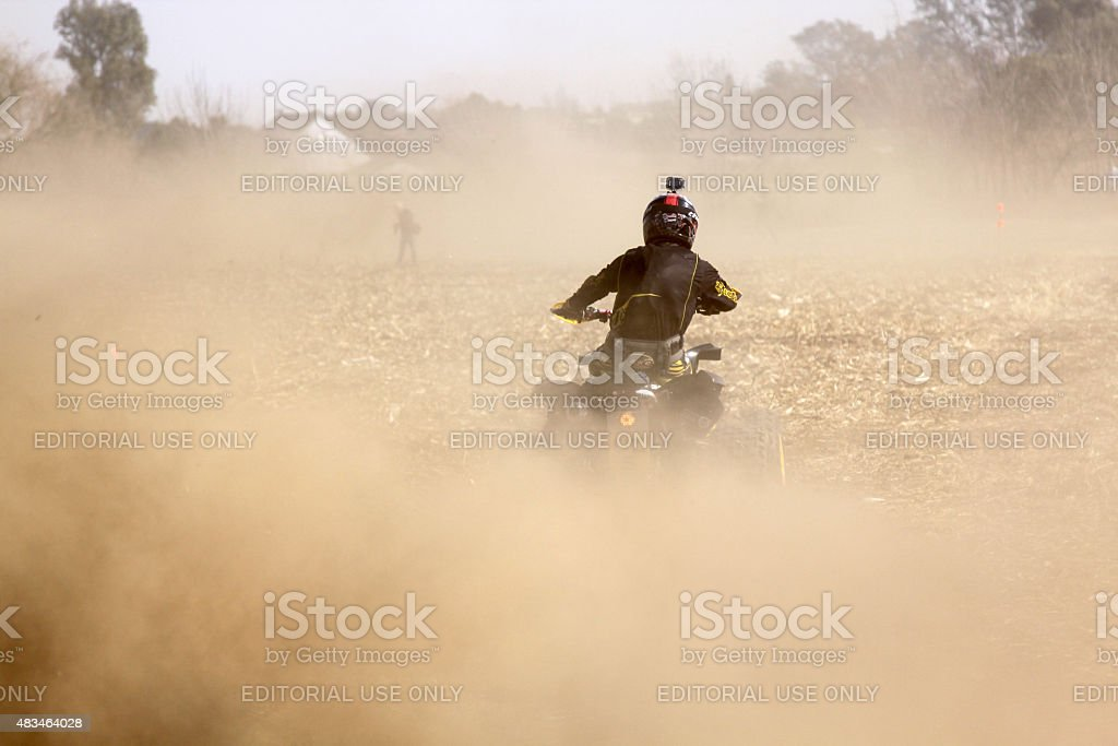 Quad Bike kicking up trail of dust at rally stock photo