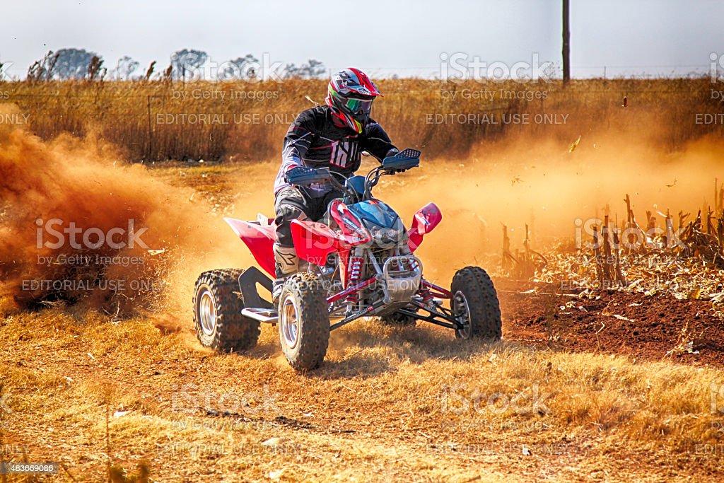 HD- Quad Bike kicking up trail of dust stock photo