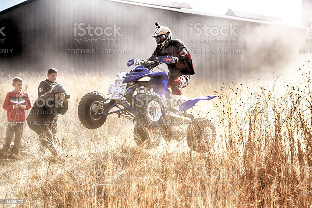 HD- Quad Bike ramping in dust stock photo