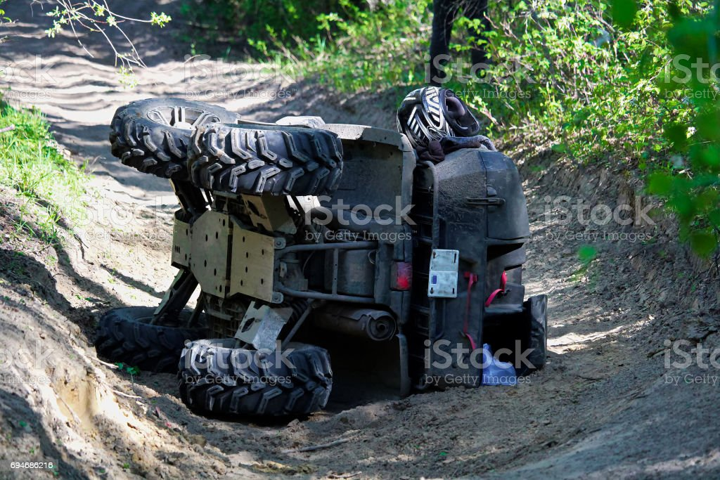 A quad on its side after it has been accidentally flipped stock photo