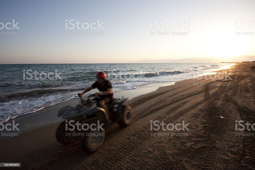 Quad riding on the beach royalty-free stock photo