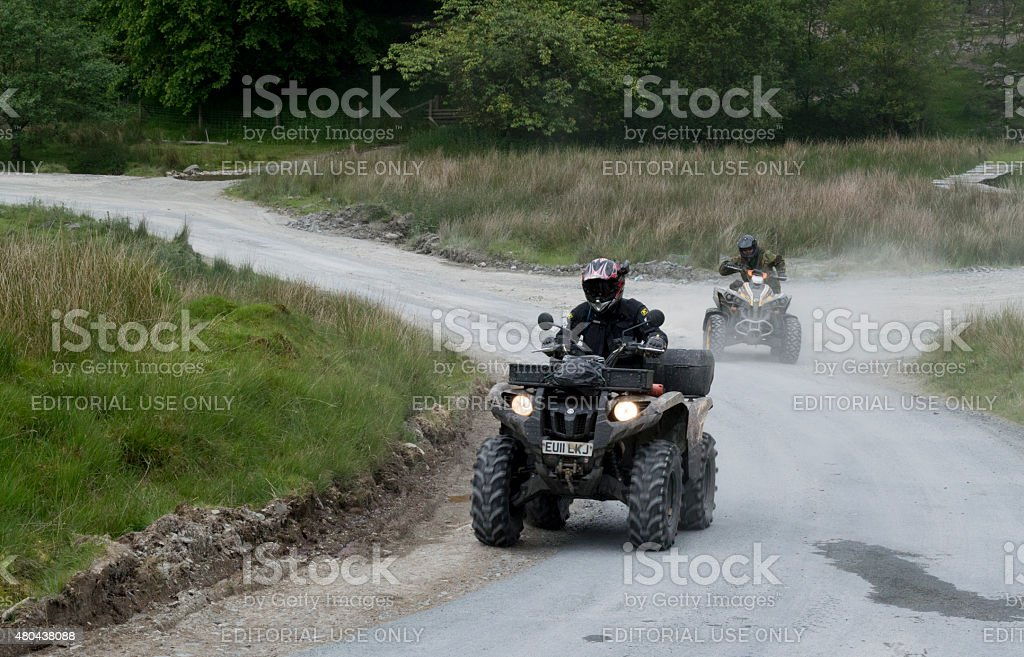 Quadbikes travelling on a Welsh hillside road in Abergwesyn stock photo