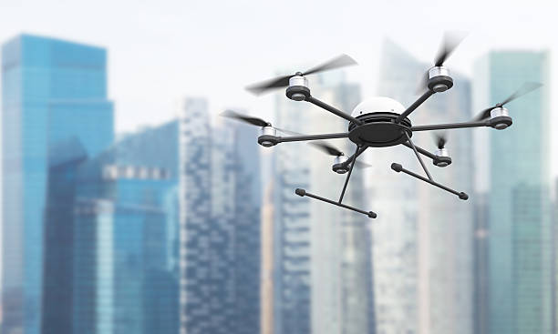 quadrocopter in singapore - drones stock photos and pictures
