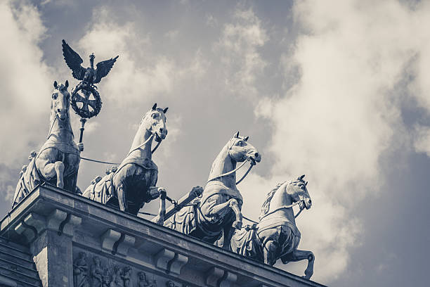 quadriga - the top of the brandenburg gate in berlin - international landmark stock photos and pictures