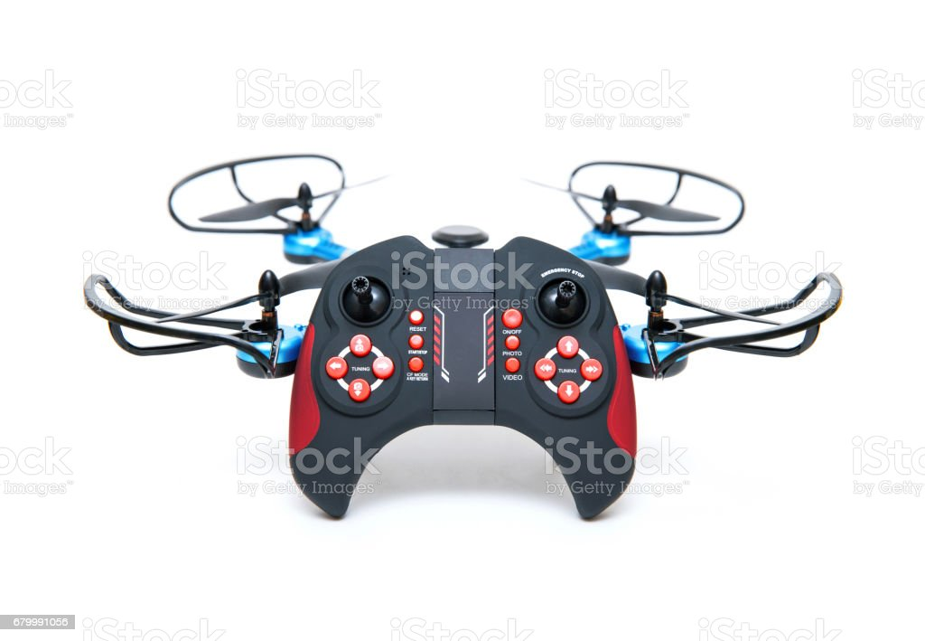 Quadrocopter and remote control isolated on white background stock photo