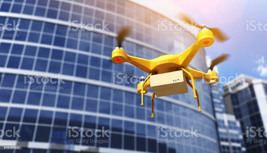Quadrocopter carrying a parcell stock photo