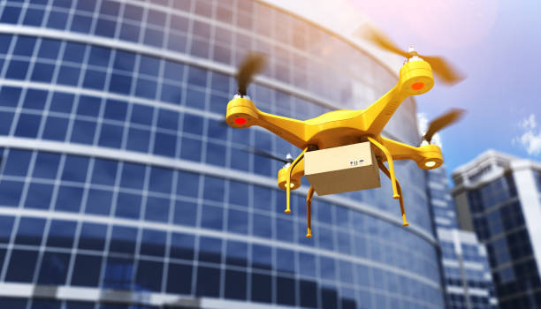 quadrocopter carrying a parcell - drones stock photos and pictures
