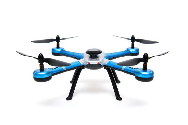 quadrocopter drone isolated on white background - drones stock photos and pictures