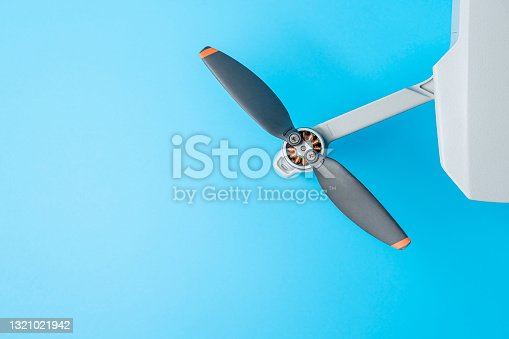 istock quadrocopter on a blue background close-up. drone 1321021942