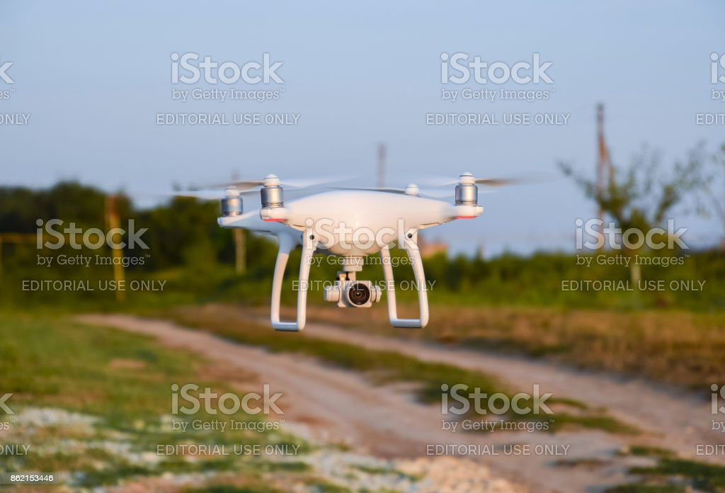 Quadrocopter on roads and background trees stock photo